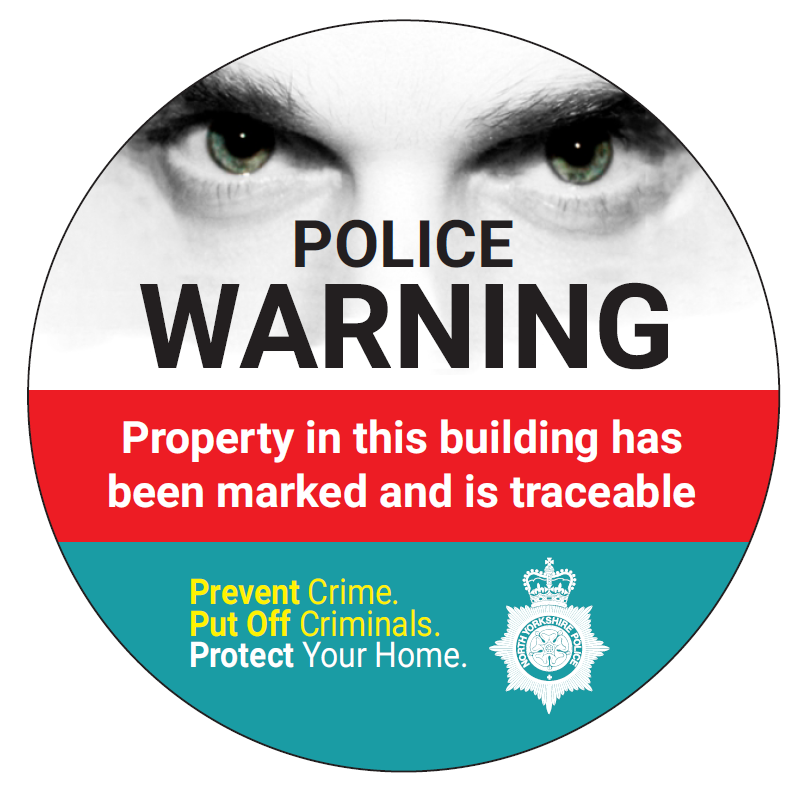 Window sticker. Police warning. property in this building has been marked and is traceable